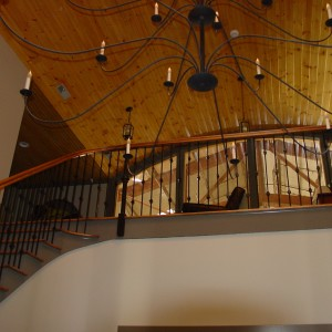 Candle Chandelier in the interior of a custom stable by Old Town Barns
