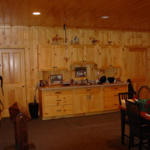 Stable Interior tack room with eastern white pine paneling and cabinets with a marine varnish finish