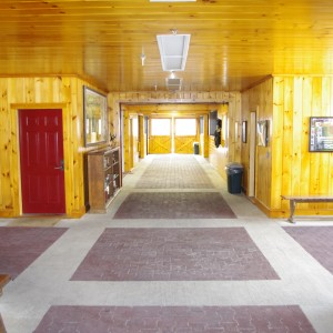 Custom Stable Interior with rubber brick pavers in the main aisle