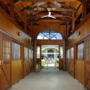 Custom Stable Interior with Vaulted Ceiling by Old Town Barns