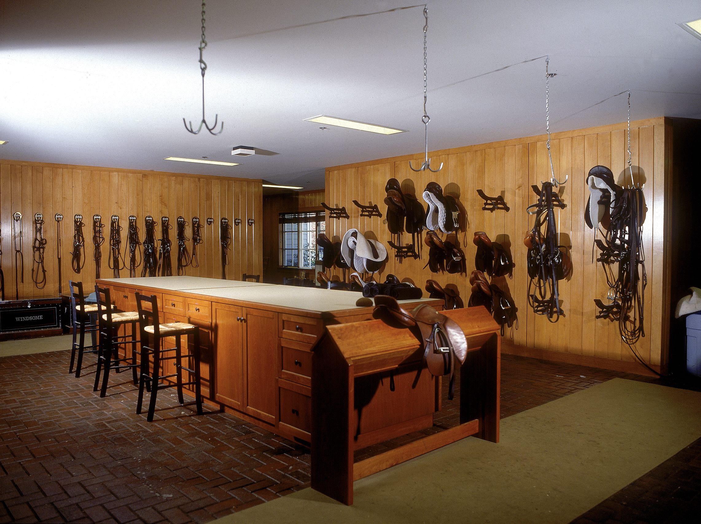 Large Tack Room Inside A 48 Stall Barn With Maple Paneling And 4x8 Concrete Paving Stones On The Floor Old Town Barns