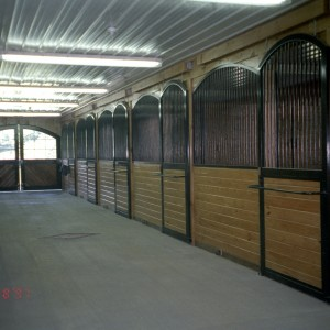 Custom Arched Stall Components in a Custom Barn by Old Town Barns