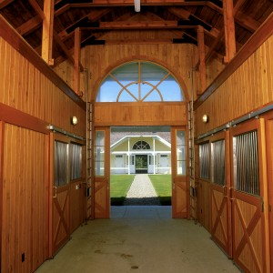 Clear Southern Yellow Pine Paneling and Stainless Steel Grill Work in this Custom Stable