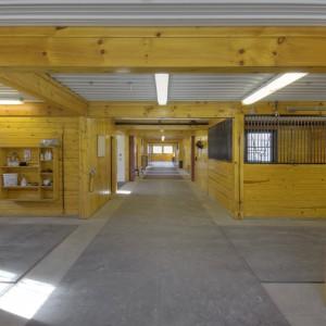 Custom Stable Interior with half inch lock mats for aisle flooring