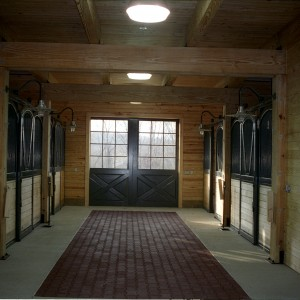 Custom Stables - 14x14 stall fronts with rubber brick pavers set flush against concrete borders
