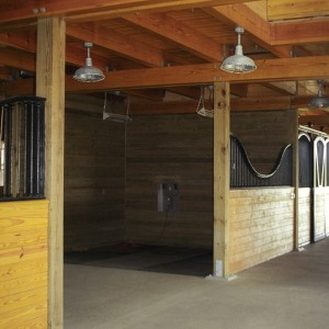 14x14 Grooming Stall with an Arched Grill in a Custom Stable by Old Town Barns