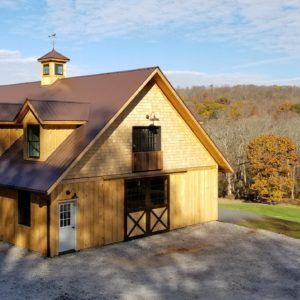 Natural Wood Stable Exterior by Old Town Barns