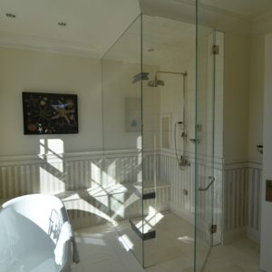 High-end Bathroom with Glass Enclosed Shower and Tub in Custom Luxurious Barn Home