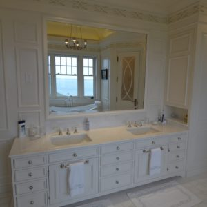 High-end Bathroom with White Double Vanities in Custom Luxurious Barn Home