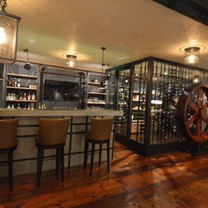 Wine Cellar and Custom Wine Bar at a High-End, Luxurious Custom Barn Home