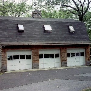3-car Gambrel Roof Garage with Skylights and cedar shakes