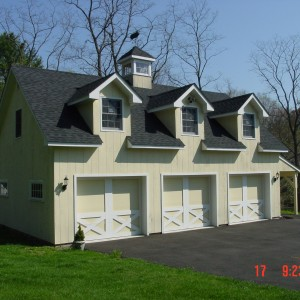 Custom 3 car garage with 3 dormers and a cupola