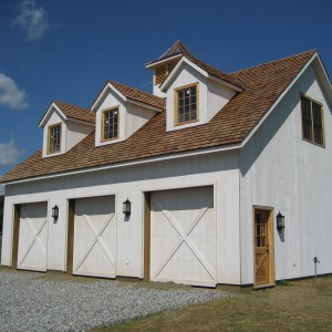 Old Town Barns White Garage with 3 bays and a small copper roof turret