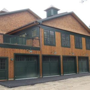 4 Bay Garage with Natural Wood and Green Doors with windows