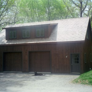 2-bay brown board and batten garage by Old Town Barns