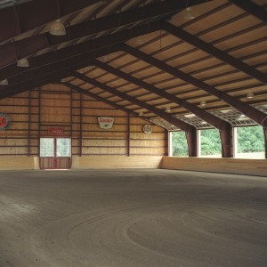 95x185 steel indoor riding arena with roof girts 48in. on center decked 1in tongue groove plywood stirrup guard 54in tall.
