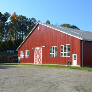 Red Exterior of a Riding Arena by Old Town Barns