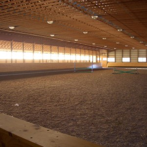 Interior of a Custom Riding Arena by Riding Arena Builders Old Town Barns