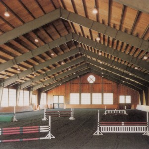 100x210 Indoor Riding Ring with Overhead doors that sit on top of stirrup wall