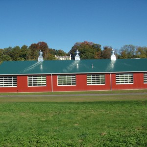 Custom Red Riding Arena Construction by Old Town Barns