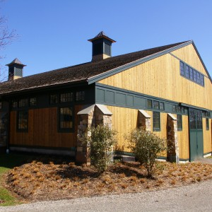 Old Town Barns Riding Arena Builders, Cedar Exterior with dark green trim