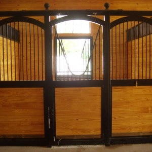 A Stall in the interior of a custom stable by Old Town Barns