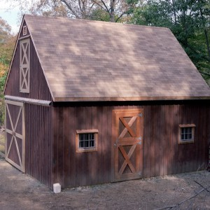 Small brown stable designed by Old Town Barns