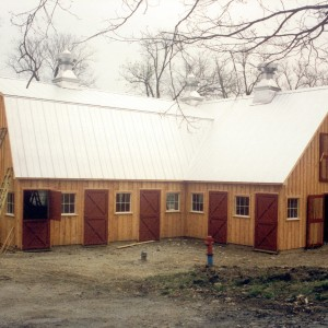 Wooden Stable with Red Doors being built by Old Town Barns