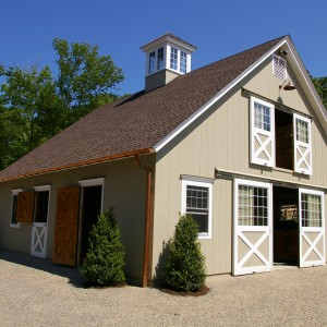 Tan Stable Exterior with White Accented Barn Doors