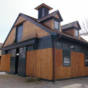 Custom Designed Stable Exterior with Cedar and Green Trim
