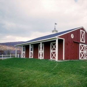 4 stall red barn with a truss roof