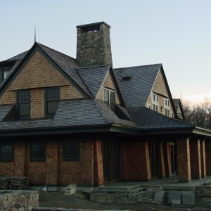 Luxury Barn Design with Cedar Shingles and Green Trim