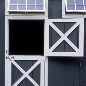 Horse Stable with a close up of a Dutch door with transom window
